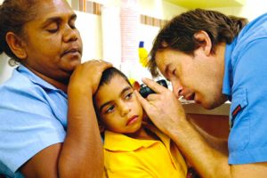 dr checking the inner ear of a child